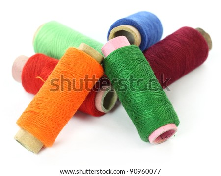 Thread reels over white background