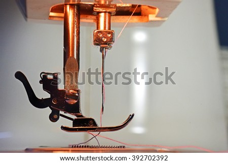 Threaded needle of a sewing machine, closeup. - stock photo