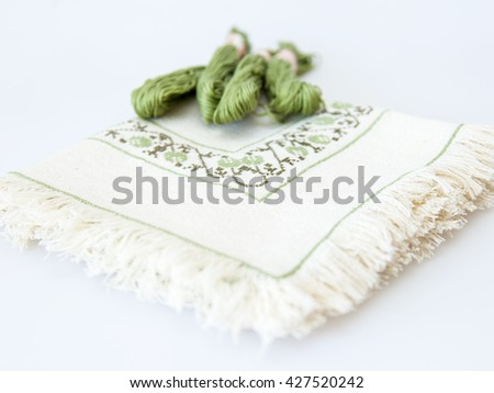 Threads for embroidery and the embroidered napkin