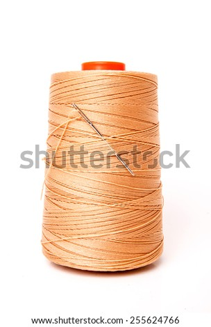 Threads Reel Nylon (Yellow,Orange,Brown) with Needle for Embroidery isolated on white background / Concept and Idea of Textile Factory, Fashion Industry and Denim made. - stock photo