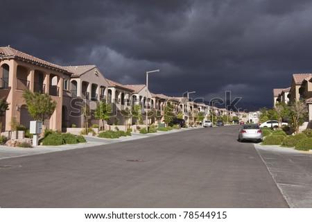 Threatening storm approaches a generic desert suburban street in Las Vegas Nevada. - stock photo