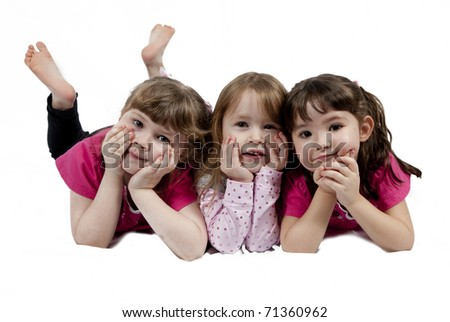Three Adorable little girls isolated on white background - stock photo