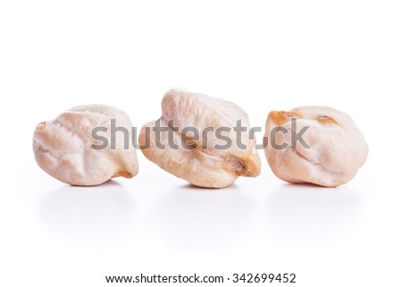 Three align raw dry chickpeas on white background, healthy vegan food with a lot of protein