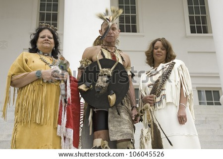 Three American Indians and Powhatan Tribal members posing in front of State Capitol during ceremonies for the 400th Anniversary of the Jamestown Settlement on May 3, 2007 - stock photo