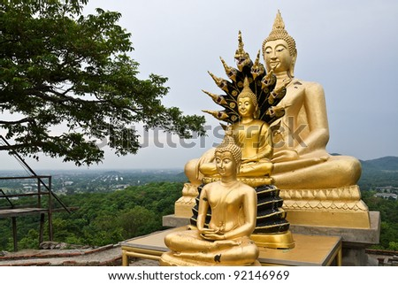 Three ancient Buddha statue on the mountain