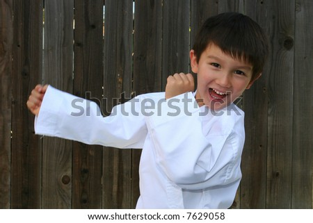 Three and half years old practicing Karate - stock photo