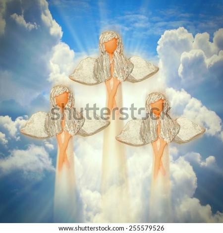 Three angels on the heaven. Spirituality concept. - stock photo