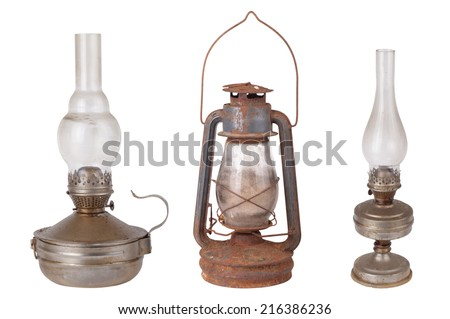 Three antique kerosene lamps isolated on white background
