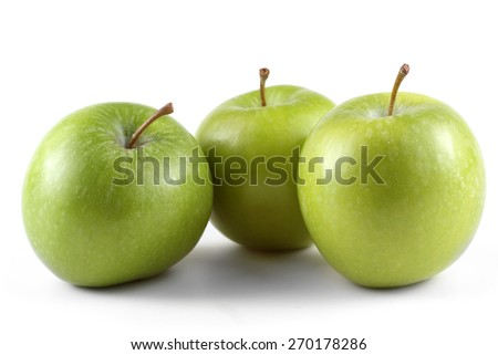Three apples. Granny Smith variety.