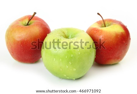 three apples on a white background