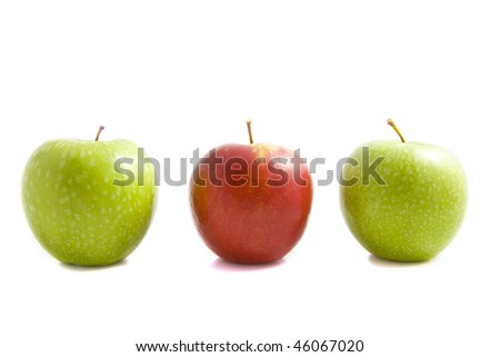 Three apples with a red one in the middle isolated over white