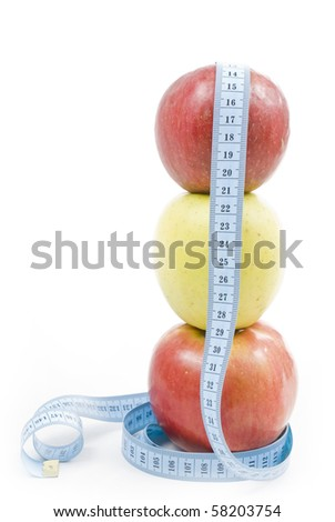 Three apples with measure tape isolated on white