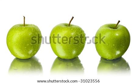 three apples with water drops with white background - stock photo