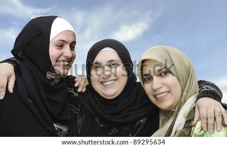 Three arabic Muslim women, portrait together - stock photo