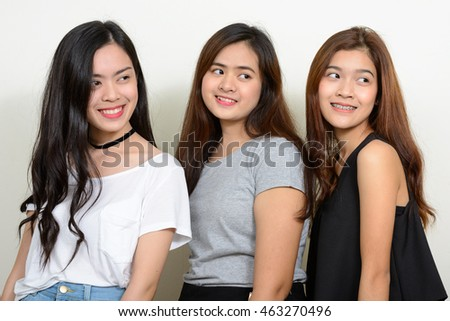 Three Asian teenager girls smiling