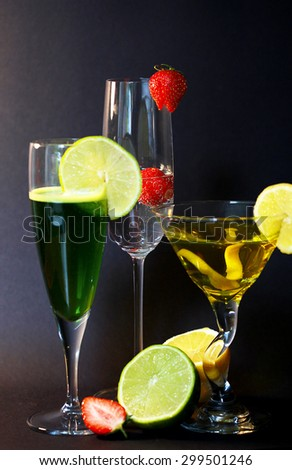 Three assorted cocktails with garnish - stock photo