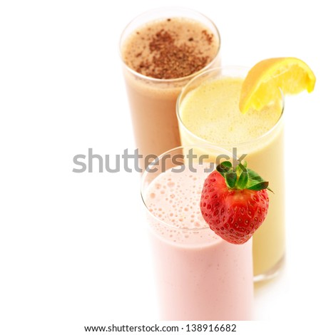 Three assorted protein cocktails on white background.