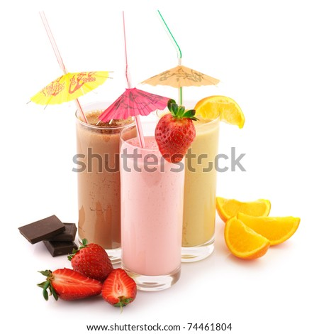 Three assorted protein cocktails with straws, decorations and fruits isolated on white background. - stock photo