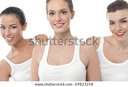 three attractive smiling women isolated on white - stock photo