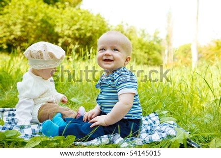 Three babies in the spring park - stock photo
