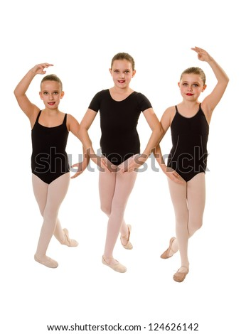 Three Ballet Student Dancers Pose in Class Leotards - stock photo