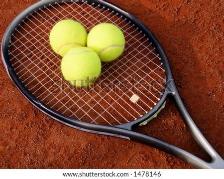 three balls and racket - stock photo