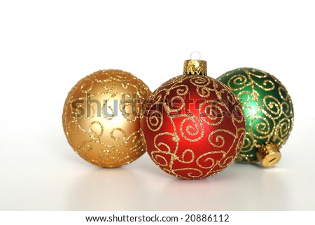 three beautiful christmas ornaments on white background with copy space - stock photo