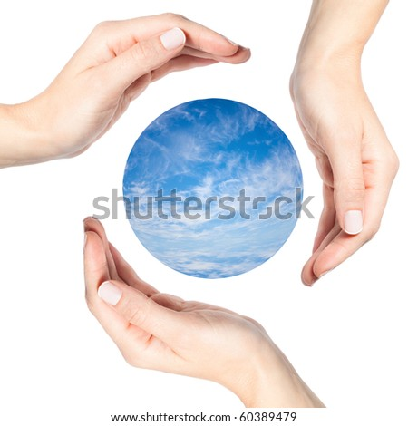 Three beautiful female hands surrounding a sphere of water and clouds - stock photo