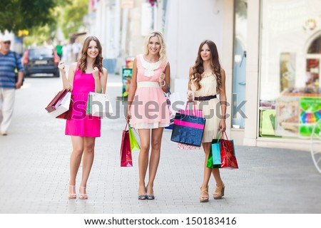 Three beautiful girlfriends with with Shopping Bags