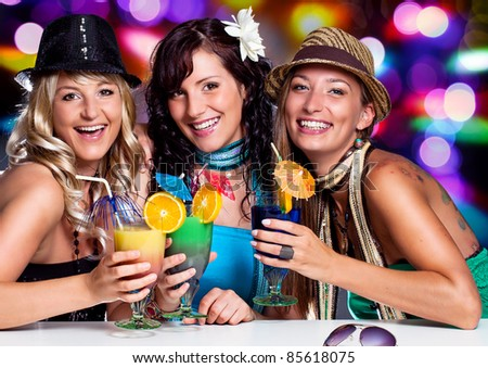 three beautiful girls celebrating in a club - stock photo