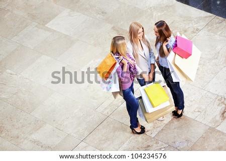 Three beautiful girls in shop - stock photo