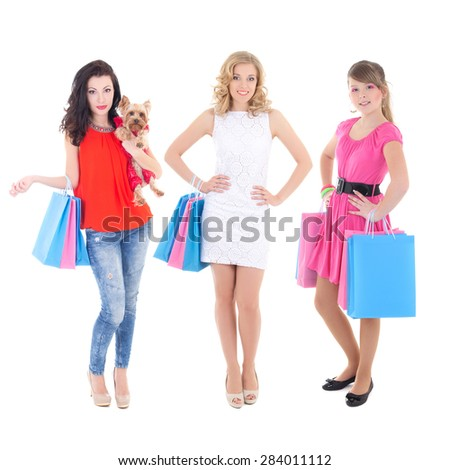 three beautiful girls with shopping bags isolated on white background - stock photo