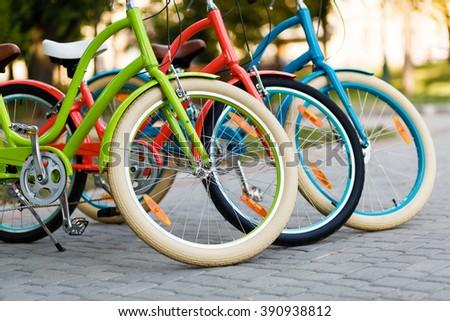Three beautiful lady city bikes.  - stock photo
