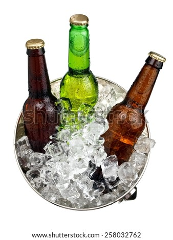 Three beer bottles in a bucket with ice, top view - stock photo