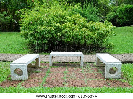 Three benches in the garden - stock photo