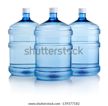 Three big bottles of water isolated on a white background - stock photo