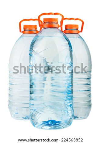 Three big full plastic water bottles with orange caps isolated on white background - stock photo