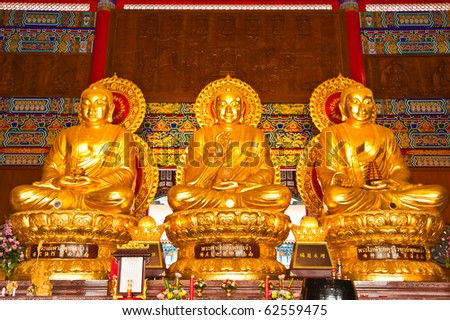 three big golden buddha in chinese style - stock photo