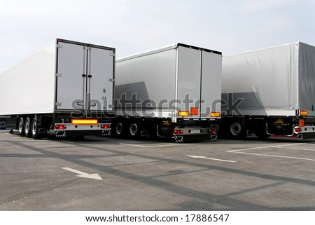 Three big lorry trailers in grey color - stock photo