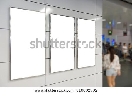 Three big vertical / portrait orientation blank billboard in public transport - stock photo