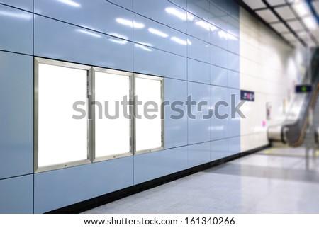 Three big vertical / portrait orientation blank billboard with escalator background in public transport - stock photo