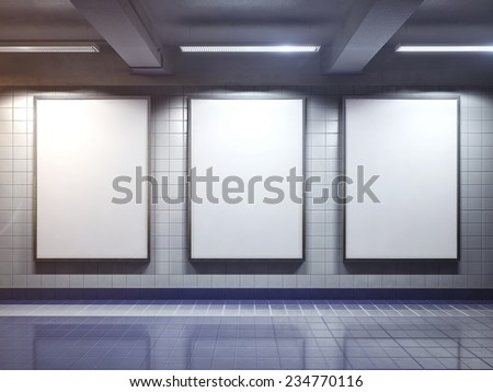 three big vertical poster on metro station - stock photo