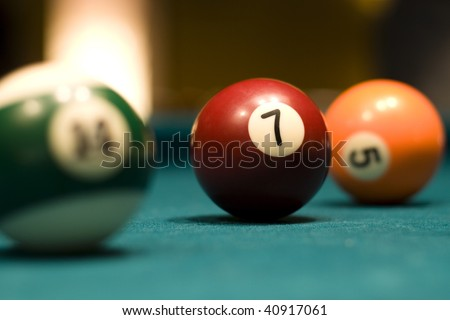 Three billiard balls on a pool table - stock photo