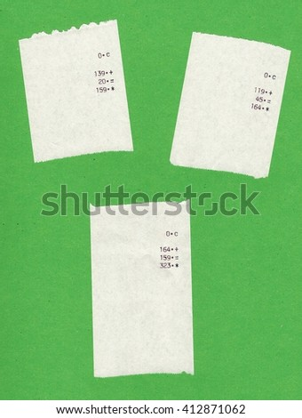 Three bills or receipts isolated over green background - stock photo