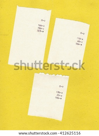 Three bills or receipts isolated over yellow background - stock photo