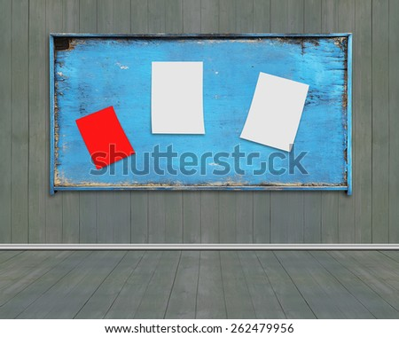 Three blank papers posted on old blue weathered noticeboard with dark green wood wall and floor background. Marked with your own message. - stock photo