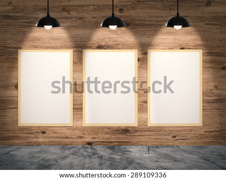 three blank picture frames on gallery wall - stock photo