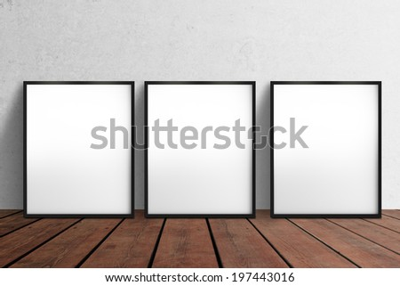 three blank poster hanging on wall - stock photo