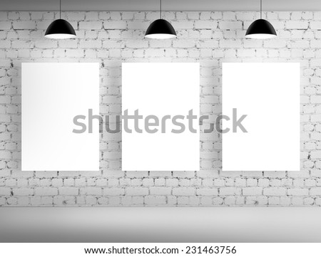 three blank posters on brick wall - stock photo