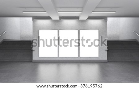 Three blank vertical billboard in the underground, stairs up on both sides. Grey walls. Front view. Concept of underground advertising. 3D rendering